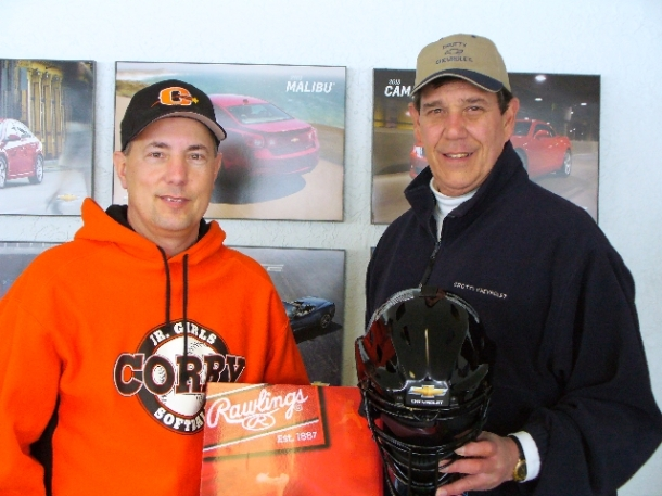 John Crotty of Crotty Chevrolet presents Dan Gates President of Corry Little League with new equippment
